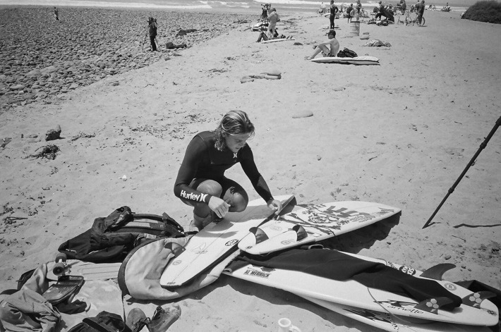Conner Coffin prepping for another session at Trestles. 35mm
