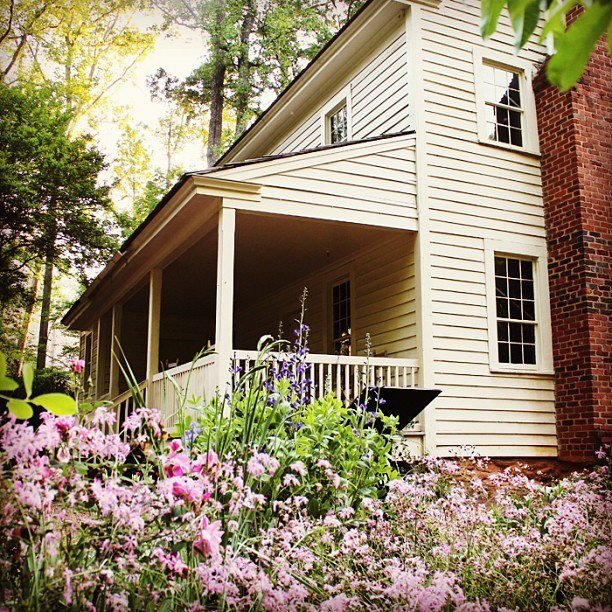 Flowers blooming in front of the AHC's historic Smith Farm House.