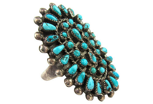 Large sterling silver and turquoise Zuni cluster statement ring made prior to 1960. Each natural turquoise stone is hand filed down to the shape of petit point (or teardrop), snake eye (round), and triangle shapes. The top of the shield is also decorated with silver dots and twisted wire. Size 11.25. Sold by Ruby + George on One Kings Lane Vintage and Market Finds