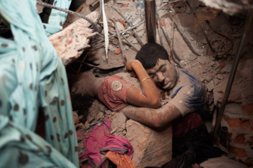 "really-shit:  A Final Embrace Photographer Taslima Akhter captured the above image following the recent factory collapse in Dhaka, Bangladesh. The image documents two workers, embraced, in the factory rubble. Sadly, the two did not recover from the incident. Here's what Taslima had to say: ""This image, while deeply disturbing, is also hauntingly beautiful. An embrace in death, its tenderness rises above the rubble to touch us where we are most vulnerable. By making it personal, it refuses to let go. This is a photograph that will torment us in our dreams. Quietly it tells us. Never again."" Is this what love looks like? Thanks to Mason for this!"