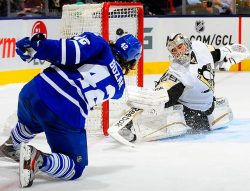 siphotos:   Toronto Maple Leafs center Tyler Bozak proves he doesn't need his skates to score, beating Pittsburgh Penguins goaltender Marc-Andre Fleury from his knees in the second period on March 14. (Greg Abel/Getty Images) GALLERY: Leading Off - Pictures of the Week