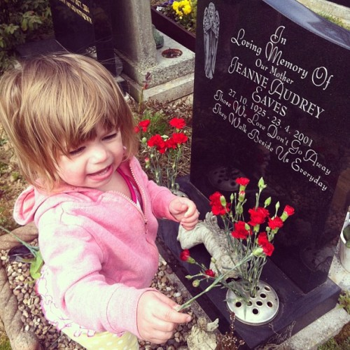 Lily helped put flowers on my nan nans grave