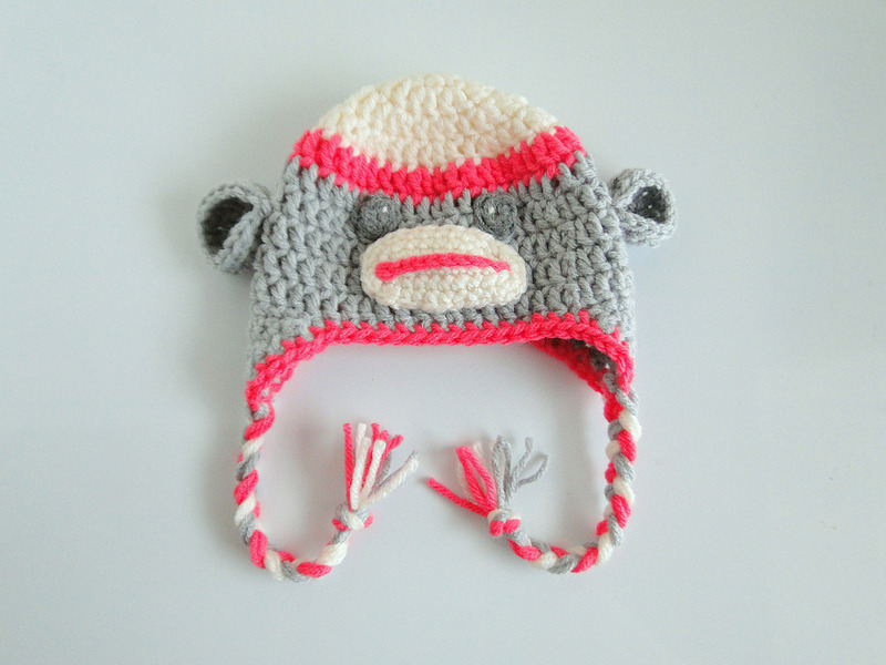 Sock Monkey Hat Casey from plus3crochet made this adorable little hat in the newborn size for her niece. Casey used the Repeat Crafter Me pattern found here.  I'm loving her colour choices — super cute!