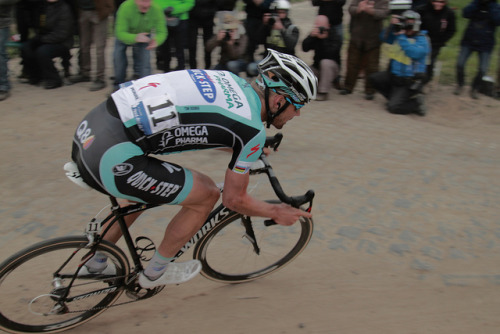 Tom Boonen | Paris-Roubaix 2012 on Flickr.Via Flickr: Paris–Roubaix is a one-day professional bicycle road race in northern France near the Belgian frontier. From its beginning in 1896 until 1967 it started in Paris and ended in Roubaix (hence the name); since 1968 the start city has been Compiègne (about 60 kilometres (37 mi) north-east from Paris center) whilst the finish is still in Roubaix. Famous for rough terrain and cobblestones (setts),[n 1] it is one of the 'Monuments' or Classics of the European calendar, and contributes points towards the UCI World Ranking. It has been called the Hell of the North, a Sunday in Hell (also the title of a film about the 1976 edition of the race), the Queen of the Classics or la Pascale: the Easter race.[1] The race is organised by the media group Amaury Sport Organisation annually in mid-April. First run in 1896, Paris–Roubaix is one of cycling's oldest races. It is well known for the many 'cobbled sectors' over which it runs, being considered, along with the Ronde van Vlaanderen and Gent–Wevelgem to be one of the cobbled classics. Since 1977, the winner of Paris–Roubaix has received a sett (cobble stone) as part of his prize.[2] In recent years, the terrain over which Paris–Roubaix runs has led to specialized bikes, with unique frames and wheels, being used. Wheel punctures and other mechanical problems are extremely common because of this terrain, and often play a part in who is able to ultimately make it to Roubaix with momentum. Despite the high esteem with which the race is seen, some notable cyclists throughout history have regarded the race as a joke because of its difficult conditions. The race has also seen several controversies over the years, with many seeming winners of the race disqualified for various reasons. The course is maintained by Les Amis de Paris–Roubaix, a group of fans of the race formed in 1983. The forçats du pavé seek to keep the course as safe as possible for riders while maintaining its difficulty.