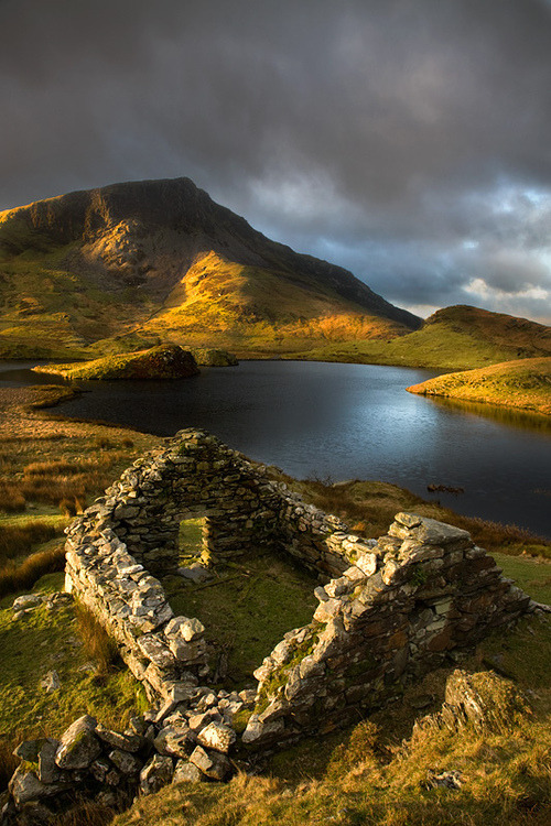mentalalchemy:  bluepueblo:   Ancient Ruins, Llyn Dwyarchen, North Wales photo via hobbitlad