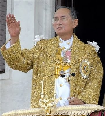 "onlynina:  thenightrecounting:   A.k.a King Rama IX of Thailand. So this guy's picture is all over Thailand and actually it's starting to freak me out. Sometimes it's big pictures in gold frames. Sometimes it's little pictures over a door. They have young King Rama, old King Rama, King Rama the naturalist, King Rama with his wife, King Rama doing stuff, but always always always the glasses. Look:  I mean he makes those glasses look good, but still, sometimes we wonder what Queen Rama thinks of them. Speaking of these glasses, this week I learned that my Dad could be the King of Thailand, if the glasses are in some way integral to the job. Which they appear to be. Here's what's freaky. 1. At 6:00 pm one day we were coming off the elevated train and walking through the station when I noticed that everyone was holding still. The dozen or so people in that part of the station had just stopped. And there was a march playing over the PA. One of those jaunty ones with a choir that is very clearly patriotic. Conclusion: at 6 pm in public places the national anthem is played and everyone halts for a few minutes while this happens.  2. We went to see a movie at the theater. After the trailers had played but before the credits started, a yellow message appeared on screen in Thai and English. The theater was quiet and everyone had stood up. Everyone but us. The message onscreen said ""please stand for the singing of the Royal Anthem."" Seriously right before the start of The Great Gatsby everyone was standing while the royal anthem played. It played over drawn images of the king on a yellow background. They had the king taking pictures, the king kneeling down to speak with a beggar woman, the king sitting on his jeep reflecting, the king with his advisers. It was weird because first anything like this is weird second this is what I thought went on in North Korean cinemas third Thailand is most definitely a democracy. I went onto youtube to find the video and it turns out that there are more than one of these we love the king movies. Look, here's a one different from the one I saw. http://www.youtube.com/watch?v=l5fN5iKXzvI They really like their king.  Seth sums up one very interesting thing we witnessed in Thailand."