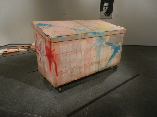 "4 days left to see Lifelike! Object spotlight: Kaz Oshiro's ""Dumpster (Flesh with Turquoise Swoosh)"", 2011. Acrylic on canvas, caster wheels The artist says, ""This dumpster for Lifelike is the fifth that I have made… I like the dumpster because I can experiment with the idea of abstract painting… The work appears to be representational painting, but I am always thinking of it as abstract painting, with the details of paint drips, dust, and rust… I see myself as a still life painter who's trying to be an abstract painter; I think the dumpster shows this transition."""