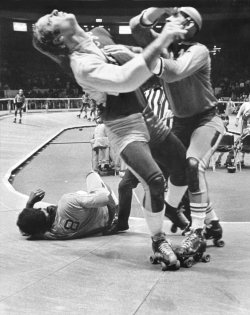 "Nov. 12, 1972: Roller derby action at Madison Square Garden, Jolters versus Chiefs. A match the next spring at Shea Stadium was put together by Jerry Seltzer (son of the sport's founder, Leo P. Seltzer) at which he addressed whether roller derby was a sham. Mr. Seltzer's reply: ""Would you question the federal government?"" Photo: Patrick A. Burns/The New York Times"