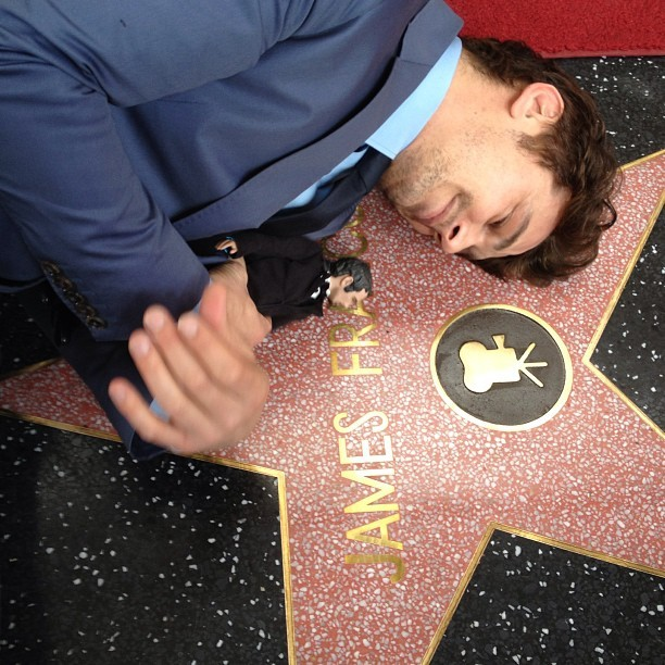 dont-lettheblueeyesfoolyou:   James Franco just received his star on the Hollywood Walk of Fame.  is that a doll of himself omg