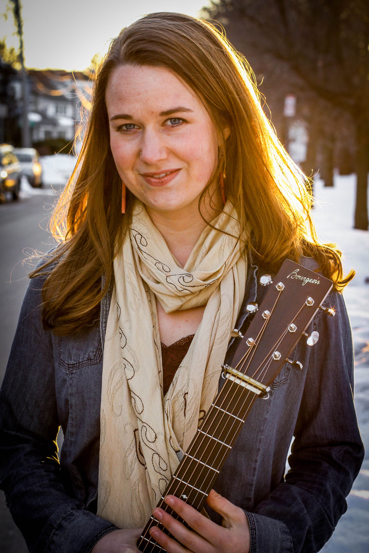 Photos of guitarist, Courtney Hartman, who plays in the bluegrass band, Della Mae.