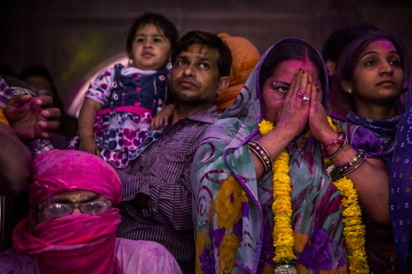 majorreisman:  Hindu devotees make offerings to a statue during Holi celebrations at the Banke Bihari temple on March 26, 2013 in Vrindavan, India. Photos by Daniel Berehulak.