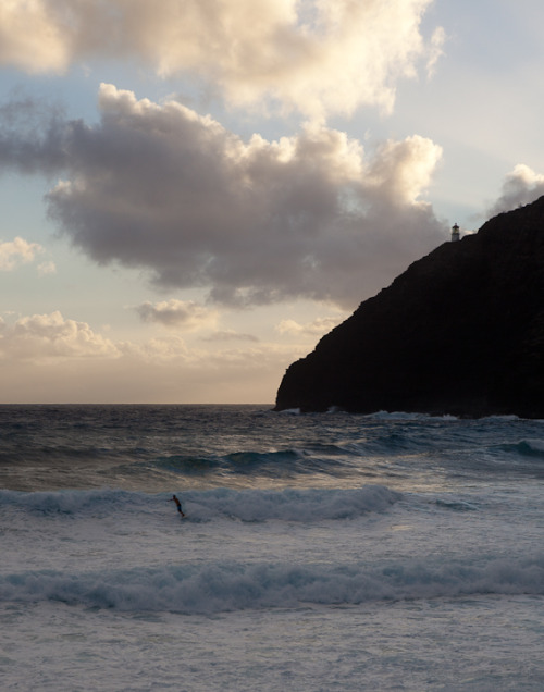 A surfer hits a right break at Makapuu.