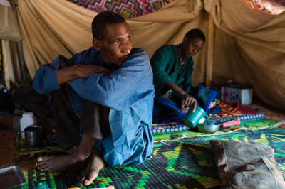 Photo: Members of a refugee family in a makeshift tent at the Mbera camp for Malian refugees. Mauritania © Nyani Quarmyne Stranded in the Desert Since the start of the conflict in Mali in January 2012, hundreds of thousands of people have fled to other locations inside the country or to neighboring countries. More than 270,000 people have been displaced within Mali, according to the United Nations, while more than 170,000 refugees have fled to neighboringBurkina Faso, Mauritania, and Niger. Mauritania hosts the highest number of refugees, with some 68,000 people registered by the Office of the UN High Commissioner for Refugees (UNHCR) in camps in Mauritania. The camps in Mauritania are located in a remote, arid region close to the border with Mali. The refugees rely completely on outside assistance and humanitarian aid for their survival, including such basic needs as food, water, shelter, and medical care.
