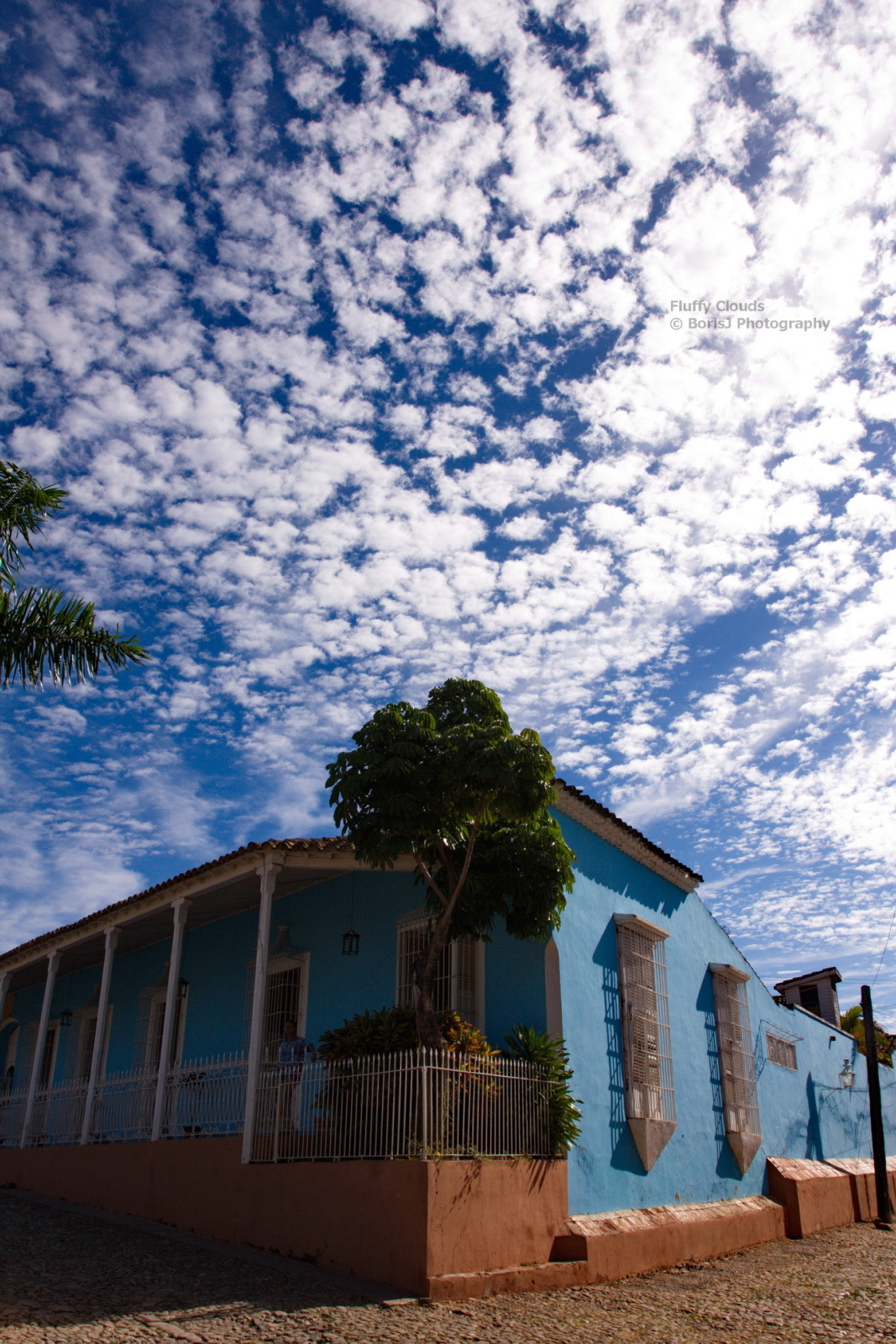 Fluffy Clouds Walking thru the Streets of Trinidad, Cuba. Canon EOS 40D1/400sISO 400f/14.1 Trinidad,Cuba Flickr - Twitter - Facebook - Google+ - Posterous - 500px Copyright © BorisJ Photography - Boris Jusseit - all rights reserved - please do not use this image on any media without my permission.