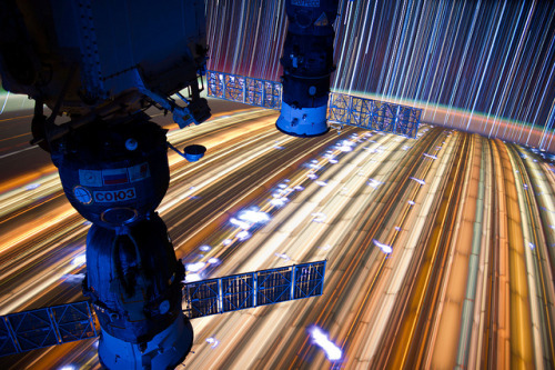 laughingsquid:  Long-Exposure Images of ISS Star Trails by Astronaut Don Pettit  Just amazing, looks like a futuristic highway. You really don't know much about life until you see images like this, really makes you think and view the world through a different lens.