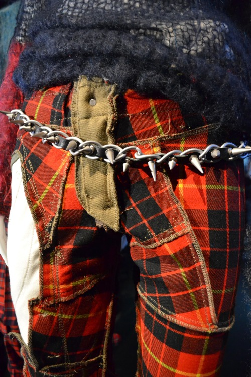 An up-close look at #punkfashion at its finest; a heavy studded belt and deconstructed tartan @metmuseum