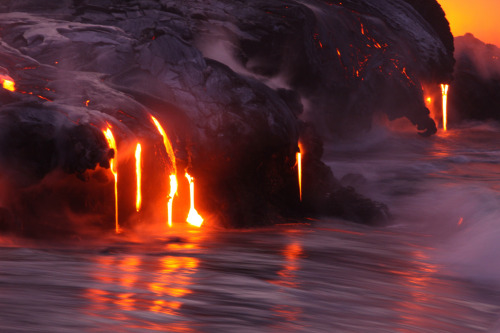 bombing:  Lava meets water off the shores of HawaiiPhotos by Nick Selway