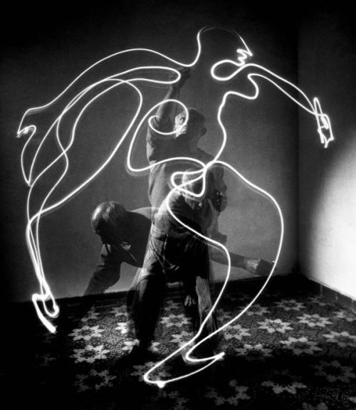 Stunning behind-the-scenes photos of Picasso painting with light. Also see this mesmerizing footage of Picasso painting on glass with a camera rolling on the other side.