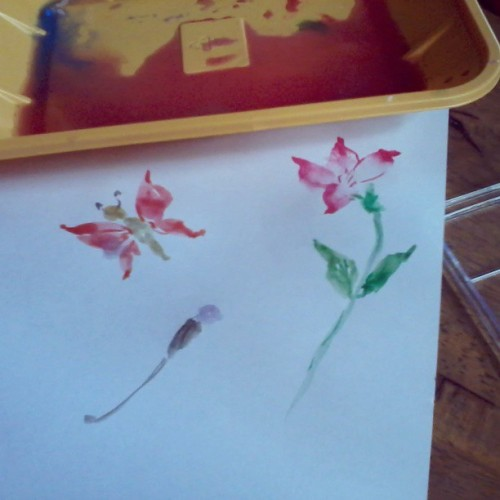 Mom dug up her Chinese painting kit for the afternoon's entertainment. A butterfly, a flower and the beginnings of a dragonfly.