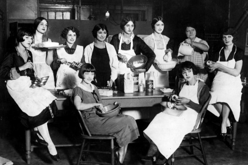 "Flappers taking a class in cooking & baking… a must if one is to be a ""proper"" lady…. Pfffft. Greenwich Village Follies, c.1925"