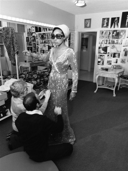 "vintageblackglamour:  Diahann Carroll with designers Bob Mackie and Ray Aghayan as they make adjustments on the cape and dress she wore for the 1975 Academy Awards. Ms. Carroll was nominated in the Best Actress category for her role in the film, ""Claudine."" Photo: Isaac Sutton for EBONY."