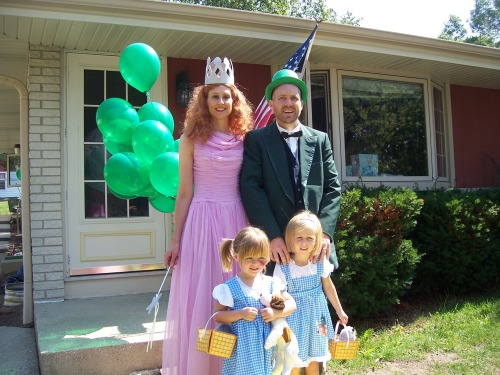 """We dress up as a family for a Wizard of Oz themed birthday party. Kristine (Good Witch), Kevin (Wizard), Annika (Dorothy 1), Sarah (Dorothy 2). We love the book because the story it timeless."" Have a great Oz photo? Click here to submit it to NPR's Backseat Book Club."