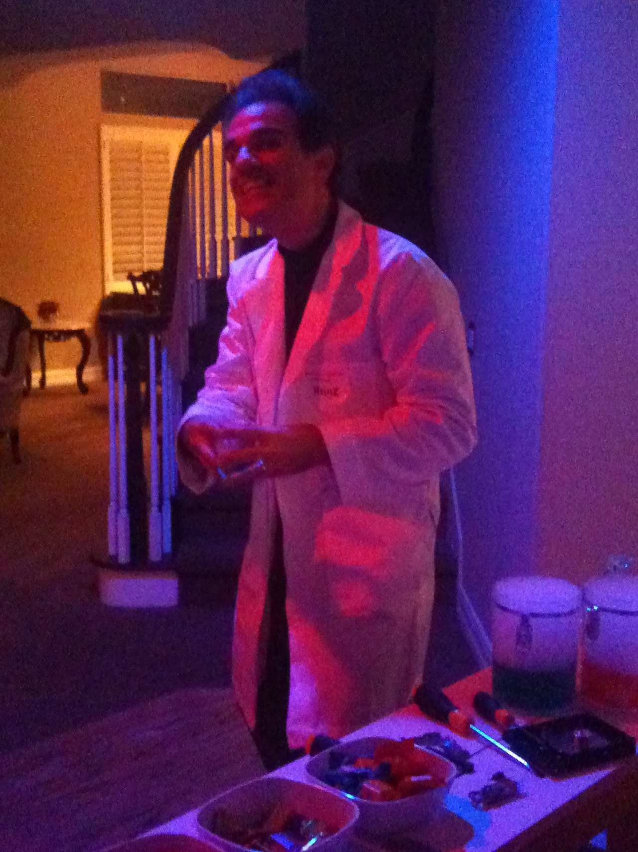 "my dad was doofenshmirtz for halloween he also had a ""candy-inator"" which he was working on, complete with dry ice (that's the stuff in the jars to the right of hi"