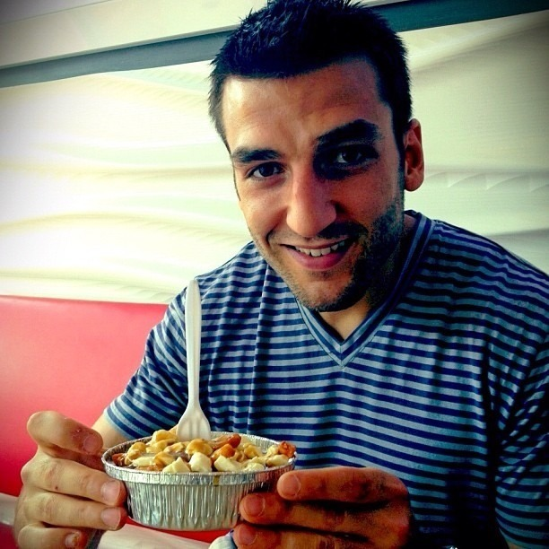 we interrupt your dashboard to bring you Patrice Bergeron holding a poutine, not a pot pie
