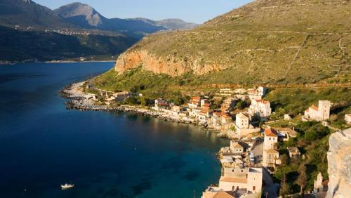 "Mani is one of the most historical parts of the Peloponnese and is situated at its southernmost area spreading over the middle ""leg"" of the peninsula. Mani has three distinguishable parts known as Main Mani, Inner Mani (East and West) and Outer Mani (Messenian).      The region of Mani is a special area, famous for its picturesque settings, authentic people, and wild landscapes. This stony, barren, salty land, stamped an indelible character to its native people…"
