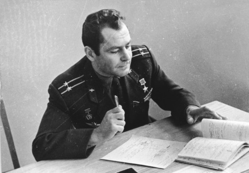 Gherman Titov working at his desk. (Source)