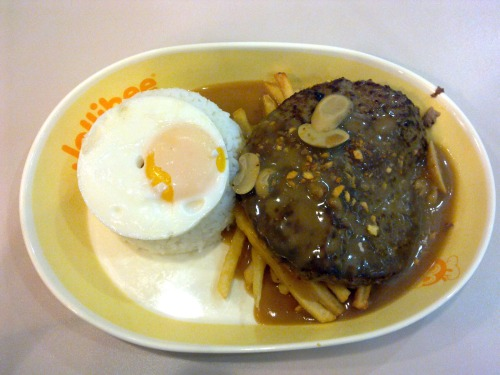 Jollibee's Ultimate Burger Steak It's Jollibee's biggest burger steak yet! A Champ patty (1/3 pound beef) on a bed of crispy french fries, smothered with mushroom gravy, served with rice and a sunny side up egg.  It's steak and eggs, fast food version! It's DELICIOUS!  The patty was moist, packed, and bursting with beef flavor.  The french fries were perfectly fried and well seasoned.  The gravy was tasty and not too salty.  The rice and egg were cooked well.  Every component was yummy! Best eaten immediately after serving. Try it and judge for yourself.