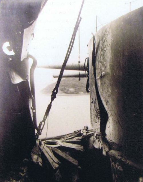 georgy-konstantinovich-zhukov:  Damage to a 6 in. gun turret on the Orel at Tsushima. The indentation of the HE shell is visible on the turret, after which it deflected down into the decking. (US Naval Historical Center)