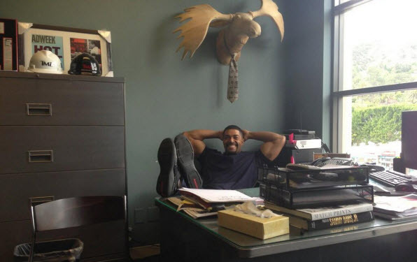 WWE star David Otunga sizing up Harvey's office.