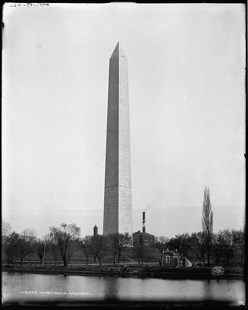 Feb. 21, 1885: The Dedication of the Washington Monument On this day in 1885, the Washington Monument was officially dedicated. Three years later, it was opened to the general public. The Washington Monument lies in the center of Washington, D.C. and it commemorates the first president of the United States, George Washington. The monument was designed by Robert Mills and it was completed by Thomas Casey. Once construction was done, the Washington Monument was the world's tallest building, measuring 555 feet.  See how the Washington Monument and other iconic locations in Washington, D.C. have changed throughout the past 100 years. Top Photo: Washington Monument in 1860; Bottom Photo: Washington Monument in 1902 (Library of Congress).