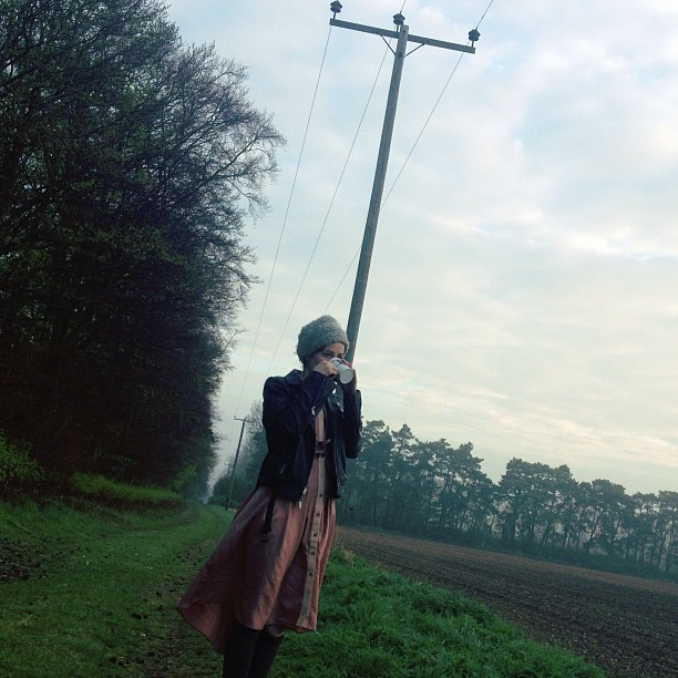 Sunrise over the hay fields.  In my lovely dress by @samanthapleet