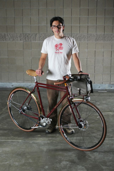 At NAHBS there was a competition for custom bikes using the Gates Carbon Drive belt system instead of a traditional chain. This is my entirely self-interested favourite the Gentleman's Town Bike with its creator Jeremy Sycip who as well as making his bike beautiful has included a sensible double kick stand, dynamo lights (using the Shimano front hub generator I currently have on test for road.cc) and the new electrically-actuated Di2 version of Shimano's 11-speed hub gears.  Here's the whole Gates piece here