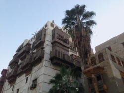 Buildings in Al-Balad (old city of Jeddah), some made of coral, with their  intricate window shutters, airy balconies, and carved doors. Beautiful and neglected.