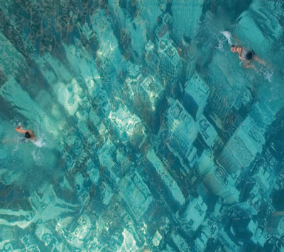 nikolawashere:  NY under water. The eye-catching swimming pool in Mumbai, India, has been built to raise awareness about the threat of sea level rises as a result of global warming.   It was constructed by attaching a giant aerial photograph of the New York City skyline to the floor of the pool.