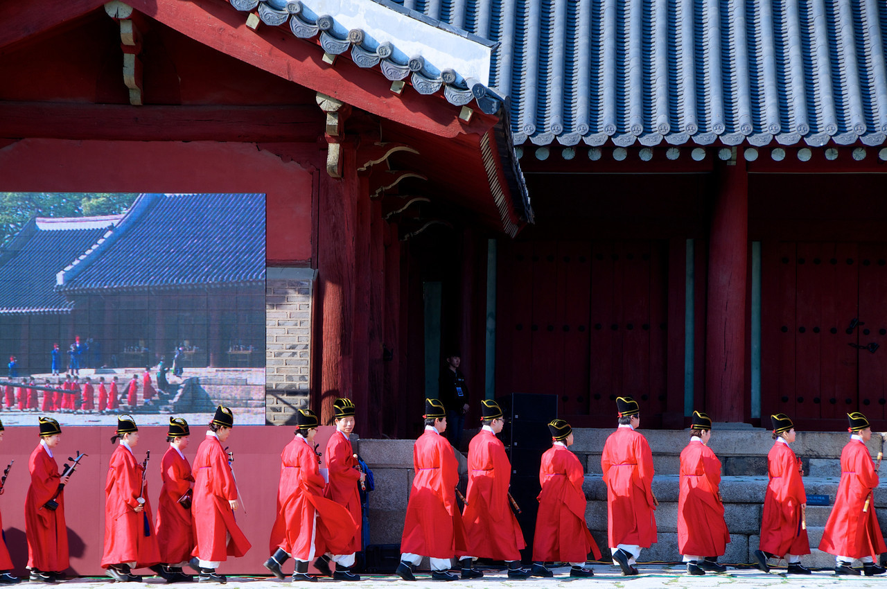 Musicians enter the courtyard of the Jeongjeon Hall, Jongmyo Shrine. The memorial rite for the kings of the Joseon Dynasty, the Jongmyo Daeje is performed by the Jeonju Yi clan, Korea's former royal family, on the first Saturday of May.