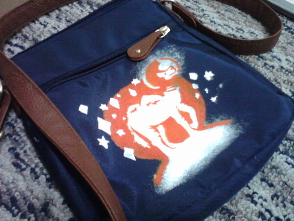 Space camel I designed and stenciled onto a bag I got from Goodwill. Space camel, man!!  Let me know if you want something like it. I can print on anything with any color (including sparkly and metalic, ohoho). I already have a couple of really nice signed prints I did in red/white/white, orange/white/white, blue/white/yellow, and freakin' GLO-IN-THE-DARK, BABY. We can negotiate a super-cheap price, seeing as that would be the only income I've had since Christmas. You up for it??   Of course you are. Contact me here.