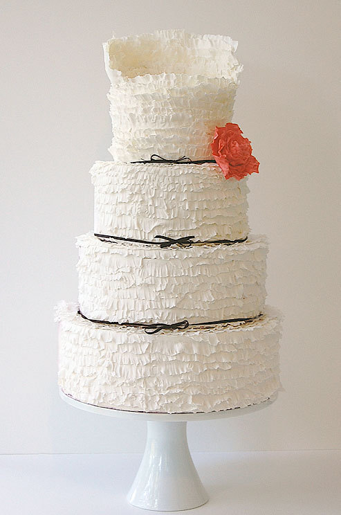pixelmusings:  A red sugar peony adds a pop of color to this ruffled cake with black bows. on We Heart It - http://weheartit.com/entry/52968860/via/pixelmusings