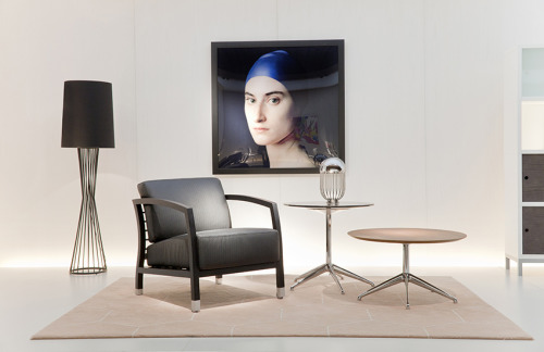 "The STUA stand in the Milano fair, with ""love your home"" concept.Malena armchair, Marea table with a Pierre Gonnord photography.STUA Design Etc"