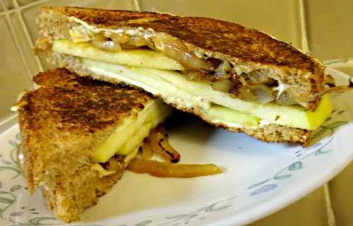 Vegan Onion and Pear Grilled Cheese!  Ingredients:  2 Tbsp. vegan butter or margarine 1/4 small onion, thinly slices 2 slices whole-wheat bread 1/2 pear, thinly sliced 1/4 cup shredded vegan cheese (Try Daiya's Mozzarella Style Shreds) Instructions: Melt 1 tablespoonful of the vegan butter in a skillet over medium heat.  Add the onions and cook until soft and caramelized, about 5 minutes. Transfer to a plate. Spread the rest of the vegan butter on both sides of each bread slice. Place one slice in the skillet and top with the caramelized onions, pear slices, and cheese shreds. Cover with the other piece of bread.  Cook until the bread is golden brown, about 2 minutes.  Enjoy!
