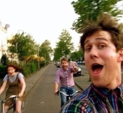 daylight-could-be-so-violent:  flogasms:  Rob taking a selfie whilst bike riding. I love this photo  this guy knows how to live life