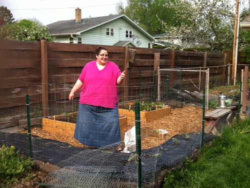 excitingfatpeople:  Exciting fat suburban gardener here! I planned and built my little oasis from scratch in an overgrown corner of the backyard. I'm really proud of the transformation. It's my first year, but I have a five year projected plan of where my next beds will go, including incorporation of a chicken run and coop. Was excited to receive my sweet potato slips in the mail, and was tucking them into their row! Other hopefuls (but no guarantees): two kinds of tomatoes, zucchini, swiss chard, two kinds of kale, bell pepper, jalapeno, bush beans, sweet corn, two different kinds of strawberries, muskmelon, two kinds of head lettuce, spinach, cucumber, cilantro, basil, thyme, lime mint, golden delicious pineapple sage (smells -just- like golden delicious apples), dill, rosemary, and I'm currently attempting to germinate some zinnias, too. Oy! Wish me luck and a green thumb!  Wow, she's so awkwardly cool! Oh wait.. that's me. ;)