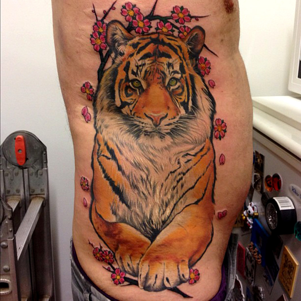 thievinggenius:  Tattoo done by Bridget Tunstall.