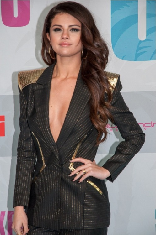 Selena Gomez busts out the cleavage for the Spring Breakers Germany premiere!