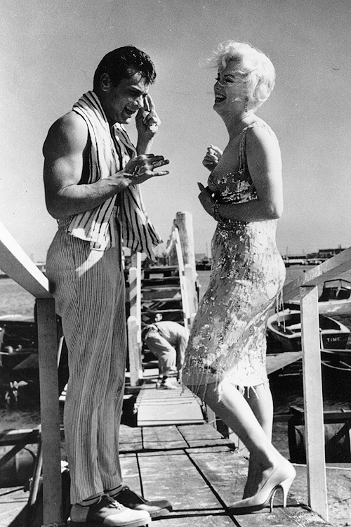 Marilyn Monroe and Tony Curtis take a break on the set of 'Some Like It Hot', 1959.