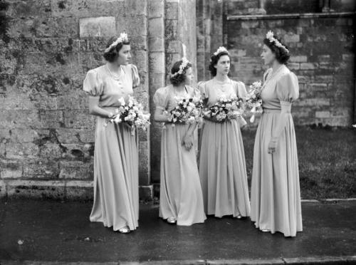 Pamela Mountbatten, Princess Alexandra of Kent, Princess Margaret and Princess Elizabeth stand outside Romsey Abbey, Hampshire in their bridesmaids' dresses after attending the wedding of Captain Lord Brabourne and Patricia Mountbatten