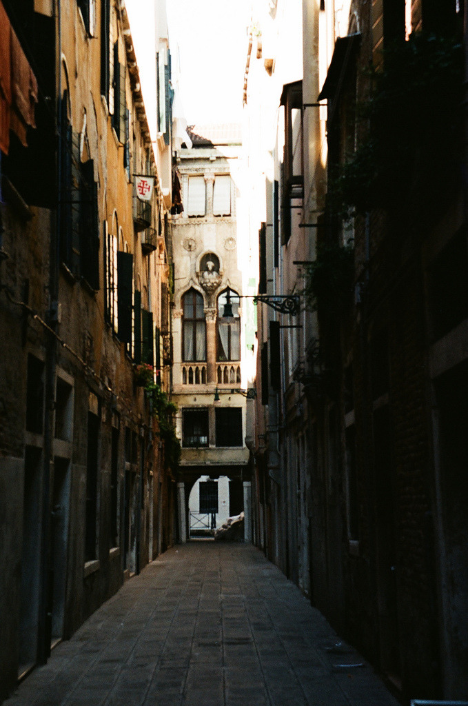 vacants:  narrow street in Venice (by whimsical jane)